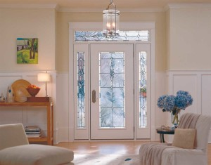 The glass door gives this entry natural light, while the furnishings, flowers and artwork add warmth.