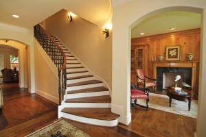 The sconces lead your eyes up the stairs, a focal point in this entry.