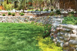 Landscaper Justin Sackschewsky created the beautiful stone walls—and it was his very first landscape job. A smaller patio by the garage provides another opportunity to reflect.