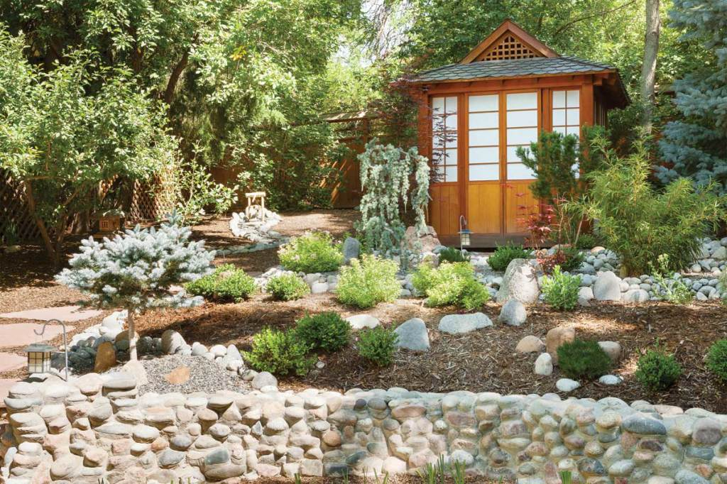 Terraced stone walls, Asian plantings and a traditional Japanese teahouse give this garden a meditative quality.