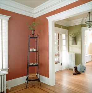 These entry and corner spaces boast strong wall colors that contrast nicely with the crisp white trim. Painting the ceilings a third color adds warmth, and directs the eye to the detailed ceiling trim. Using different wall colors defines each space as separate, but using the same ceiling and trim colors provides continuity.