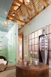 The glass bulbs and ultra-chic shower in the master bath add contemporary touches.
