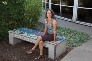 "In Jane Glotzer's hands, a decidedly plain-Jane concrete bench became an enchanting garden seat. Glotzer transformed it with mosaic tiles she creates from found materials. ""There's so much life left in (discarded) things,"" and anyone can develop an eye to see their potential, she says. (photo courtesy Jane Glotzer, www.plainjanedesignboulder.com)"