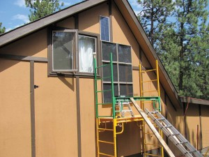A six-panel SunnyTherm being installed on a workshop in the mountains near Boulder (the blue rectangle above the panels is a solar panel that runs the blower fan, making this system completely off-grid). The owner, a weaver, was tired of having to wait for hours for her studio to warm up enough to work in. With the system in place, the space is warm in the morning when she wants to use it, she reports, and her electric-heating costs have dropped 80 percent.