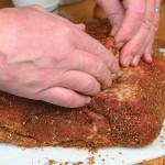 Pat the meat dry and moisten it with a light sheen of olive oil to soften the spices and help them adhere.